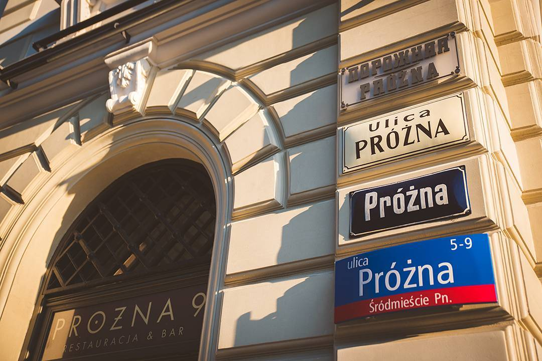 Warsaw's street signs from different decades.