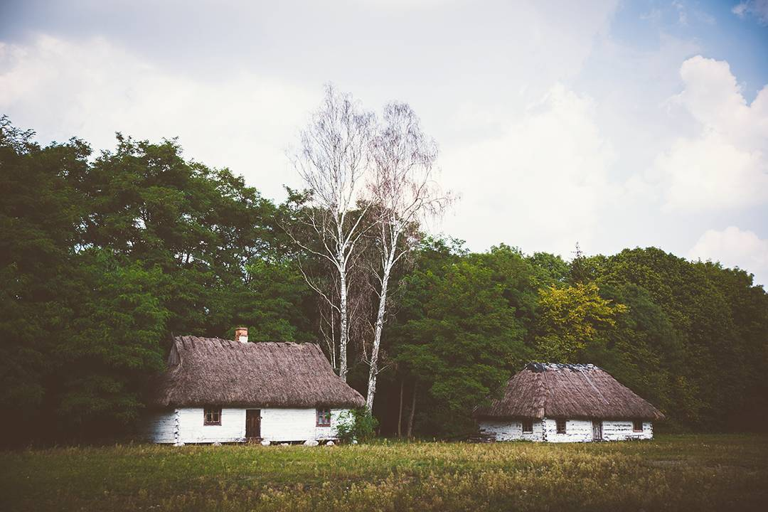 Historic thatched-roof manor houses outside of Warsaw, Poland.