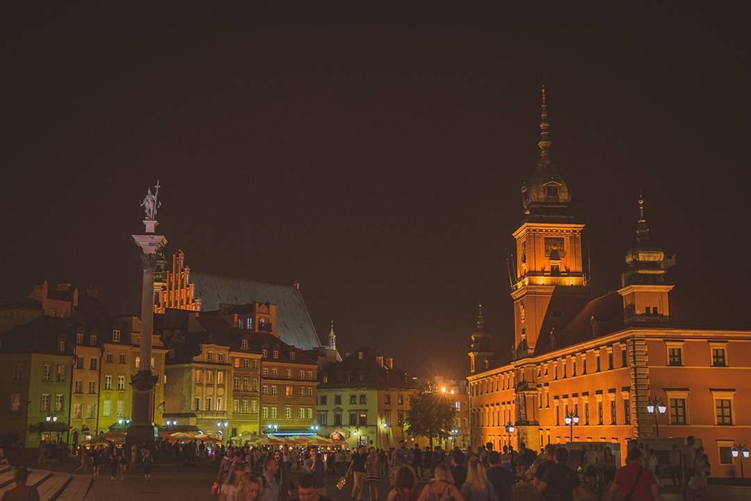 The main square of in Warsaw, Poland, at night.