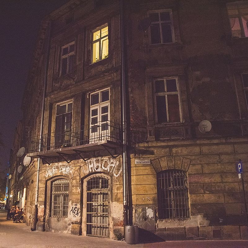 I just loved the streetlight shining on this crumbling building in Krakow at night and the glowing window above.