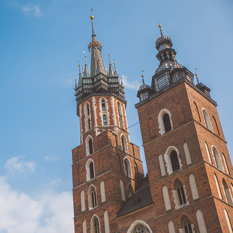 St. Mary's Basilica in Kraków's town center is famous for the trumpeter that plays from the window of its taller tower every hour and the fact that he abruptly stops mid-song in the same way a 13th century trumpeter did when he tried to warn the city that the Mongols were coming but got an arrow to the throat through the tower window before he finished his call.