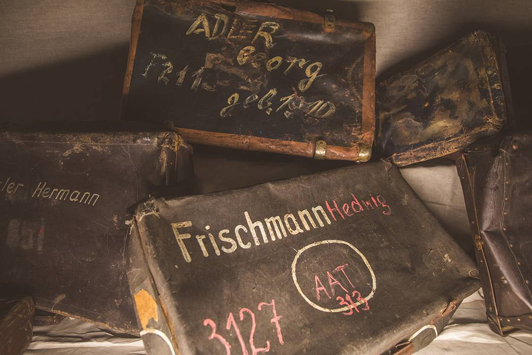 Jewish families labeled their suitcases before entering Auschwitz, thinking they would be returned later.