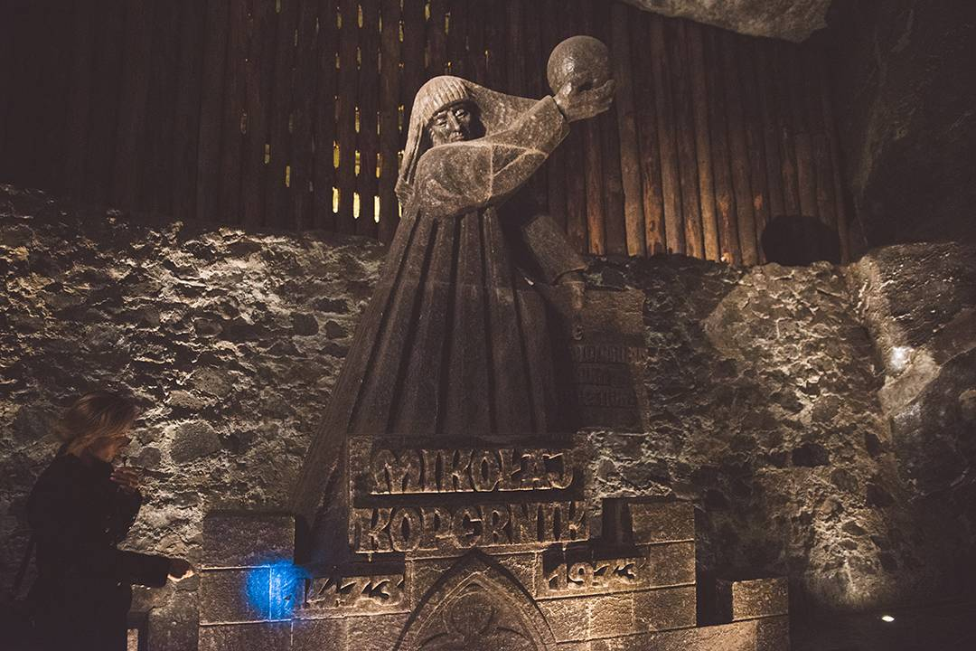 Next we went to the Wieliczka Salt Mine, which opened in the 13th century and was mined for table salt until the 1990s. We descended 378 steps into the mine, where we saw salt carvings such as this one of Nicolaus Copernicus (Mikołaj Kopernik in his Polish home), which the miners made in salt during their . . . down time? Lunch hour? I'd love to know. Here, our guide is using a flashlight to show us how translucent the salt carving is.